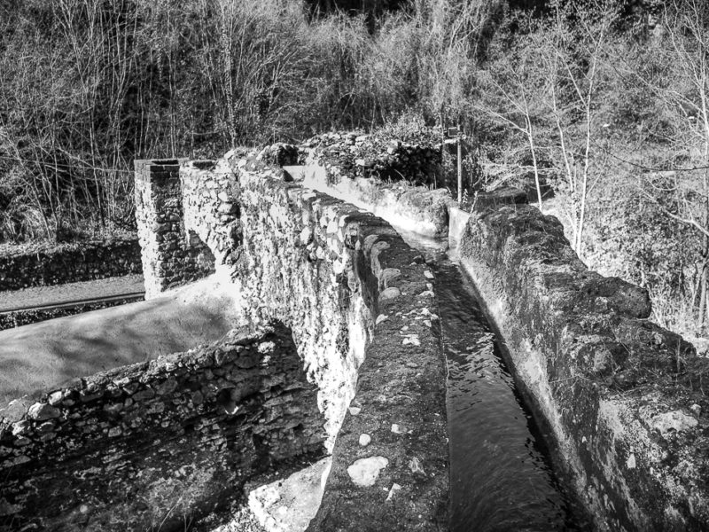 black and white photo of ruins of water mill. The Valle dei Mulini (Valley of Mills) of Gragnano, Naples, Campania, Italy